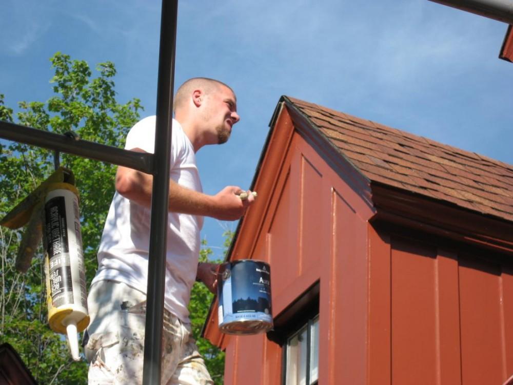 Josh on a scaffold applying Benjamin Moore's Aura