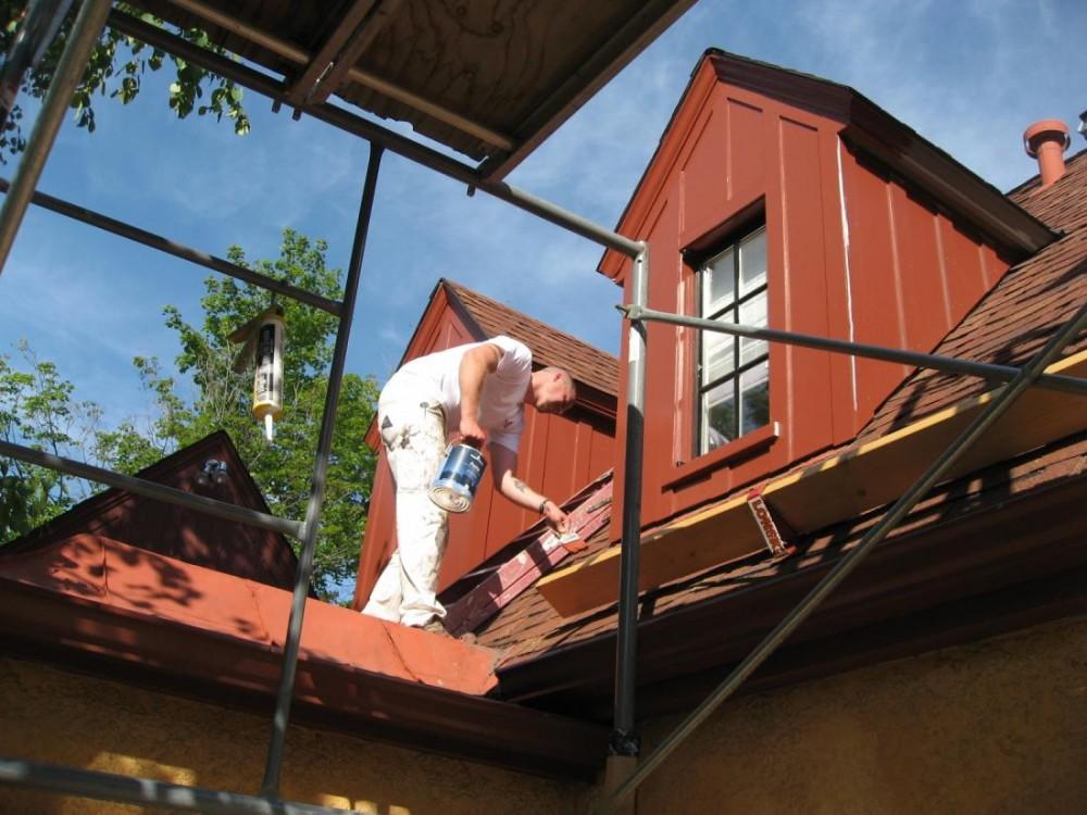 Josh on a scaffold applying Benjamin Moore's Aura 2